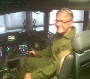 Hyer in the Cockpit of a Globemaster aircraft